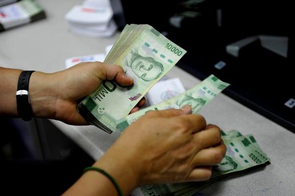 Las utilidades de la banca muestran a mayo —el tercer mes desde la llegada de la pandemia— una contracción interanual de 12%. Fotos Melissa Fernández Silva