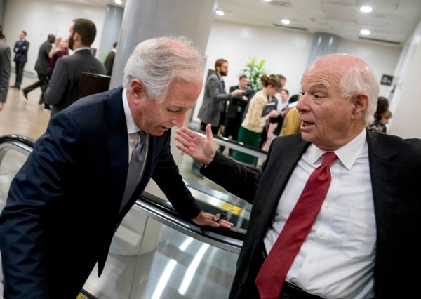 Sen. Ben Cardin, D-Md., right, speaks with Sen. Bob Corker, R-Tenn., left, at the Capitol as Congress prepares to vote on the biggest reshaping of the U.S. tax code in three decades, on Capitol Hill, Tuesday, Dec. 19, 2017, in Washington. (AP Photo/Andrew Harnik)