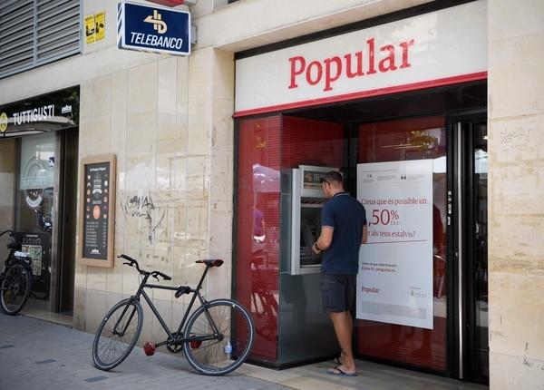 Santander recibe aval para comprar banco popular y cede for Inmobiliaria del banco santander