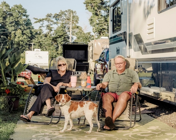 Rhonda and Ben Lieurance at an RV park in Elkhart, Ind., where some 80 percent of the recreational vehicles sold in the United States are made, Aug. 22, 2018. The Trump administration's tariffs on imported steel and aluminum are increasing costs, diminishing demand and causing concern that a 10-year boom cycle in RVs could be waning. (Whitten Sabbatini/The New York Times)
