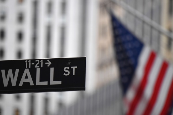 (FILES) In this file photo taken on August 31, 2020 the New York Stock Exchange (NYSE) is pictured on August 31, 2020 at Wall Street in New York City. - Wall Street's summer-long rally stumbled on September 3, 2020 with high-flying tech shares leading the market sharply lower as investors cashed in amid worries about a bubble in prices. (Photo by Angela Weiss / AFP)