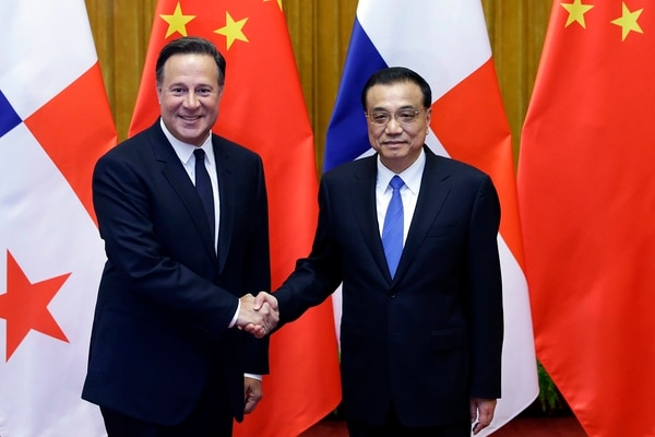 Chinese Premier Li Keqiang, right, shakes hands with Panama's President Juan Carlos Varela before their meeting at the Great Hall of the People in Beijing, China on Friday Nov. 17, 2017. (]Jason Lee/Pool Photo via AP)