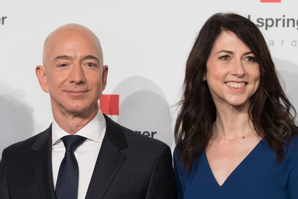 (FILES) In this file photo taken on April 24, 2018 Amazon CEO Jeff Bezos and his wife MacKenzie Bezos poses as they arrive at the headquarters of publisher Axel-Springer where he will receive the Axel Springer Award 2018 in Berlin. - Amazon founder Jeff Bezos, rated the world's wealthiest person, announced on January 9, 2019 on Twitter that he and his wife Mackenzie Bezos were divorcing after a long separation.