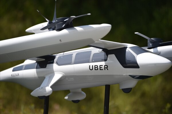A model of Uber's electric vertical take-off and landing vehicle concept (eVTOL) flying taxi is displayed at the second annual Uber Elevate Summit, on May 8, 2018 at the Skirball Center in Los Angeles, California. Uber introduced it's electric powered