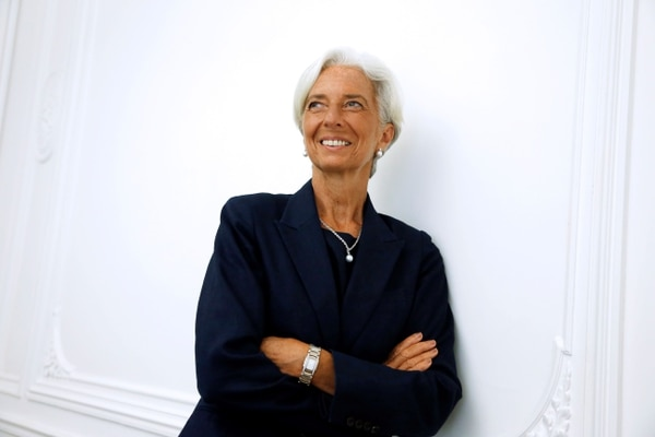 (FILES) In this file photo taken on August 27, 2014 IMF chief Christine Lagarde poses on the sideline of a press conference at her lawyer's office in Paris, after announcing she had been charged for