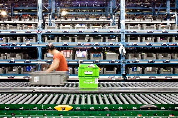 A worker prepares an order at the warehouse for Peapod, a grocery delivery company, in Jersey City, N.J., June 21, 2017. Profitably delivering perishable food to customers in big metropolitan areas is the issue that has largely vexed the industry — making groceries the last frontier of online shopping. (Bryan Anselm/The New York Times)