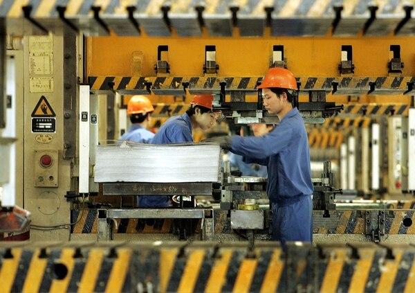 La economía mundial repuntará en el 2014 de la mano del crecimiento sostenido de China, según un informe del Banco Mundial.