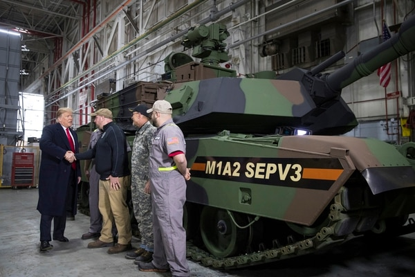 President Donald Trump tours the Lima Army Tank Plant in Lima, Ohio, March 20, 2019. Two years into Trump's term, many businesses appear to be increasingly prioritizing their balance sheets over political backlash caused by his efforts to compel them to build and hire. (Sarah Silbiger/The New York Times)
