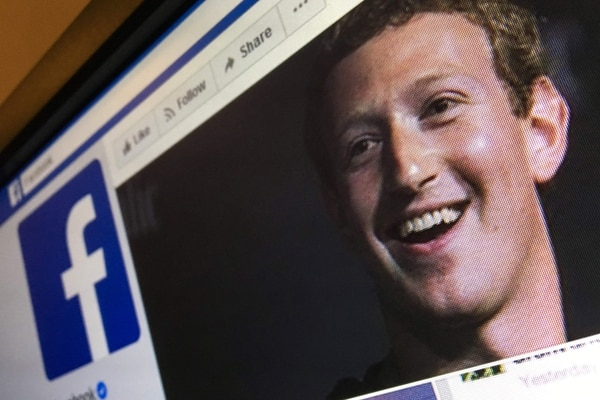 A picture taken in Moscow on March 22, 2018 shows an illustration picture of the English language version of Facebook about page featuring the face of founder and CEO Mark Zuckerberg. A public apology by Facebook chief Mark Zuckerberg, on March 22, 2018 failed to quell outrage over the hijacking of personal data from millions of people, as critics demanded the social media giant go much further to protect privacy. / AFP PHOTO / Mladen ANTONOV